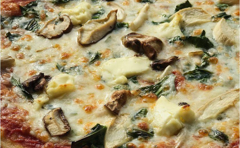 Close up of cheesy, mushroom pizza